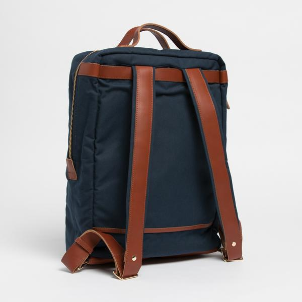 Breton Modern Day Briefcase Backpack Leather and waxed canvas straps. Classy looking on dress clothes.