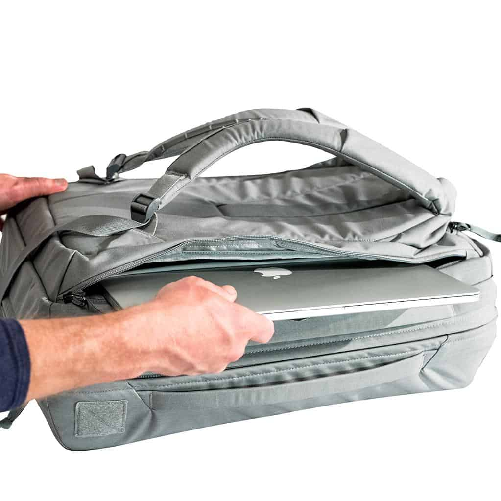 Spacious laptop compartment boasts extra clothing storage. Spacious laptop compartment boasts extra clothing storage.