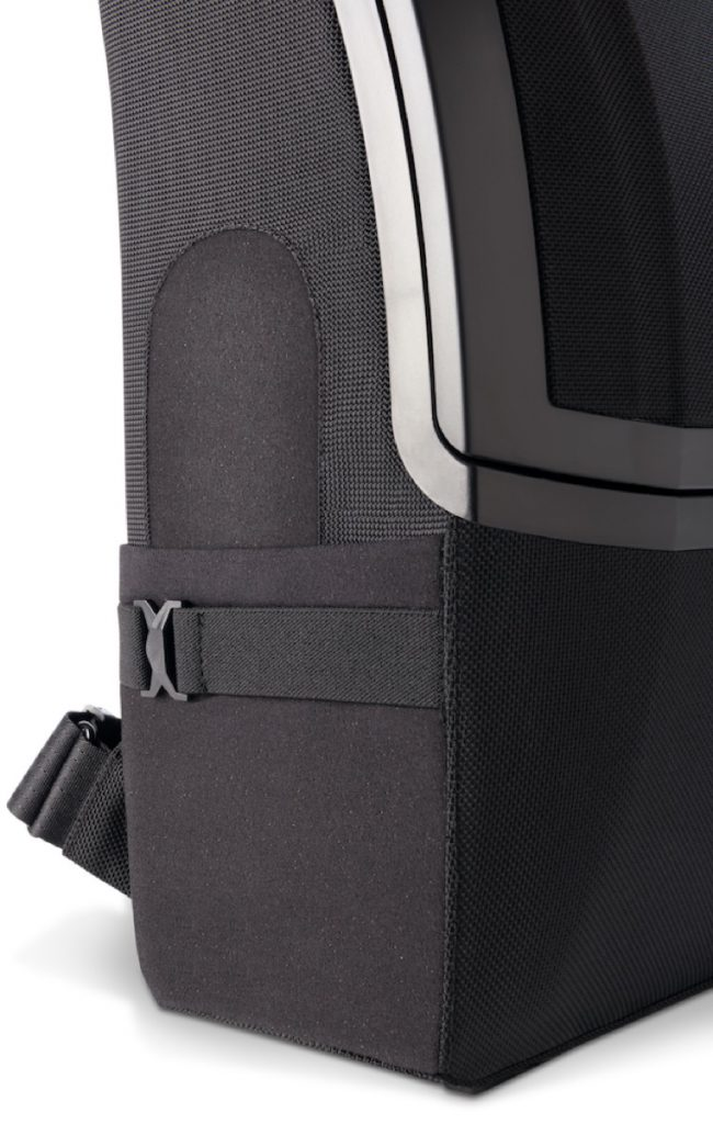 The Watson Backpack Lay-flat water bottle holder with elastic clip.